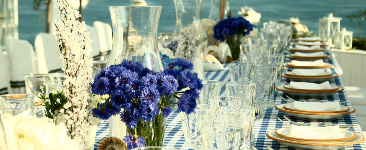 destination wedding blue flowers and table lake view 1