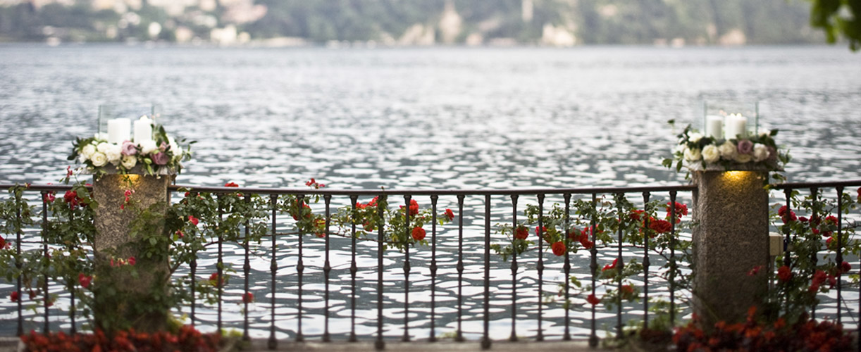 destination wedding red flowers amazing lake view 2