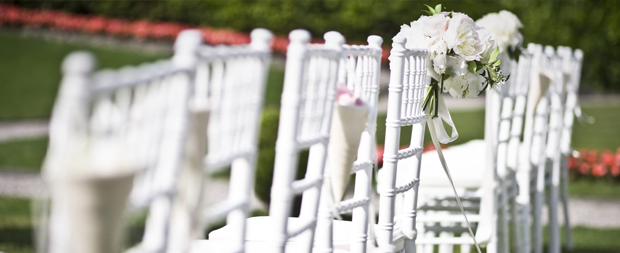destination wedding white chairs and flowers 3